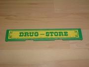 Enseigne Drug store en l'état