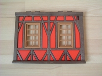 Mur de maison à colombages rouge